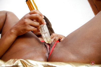 Older black woman Chiya masturbating bald twat with vibrator