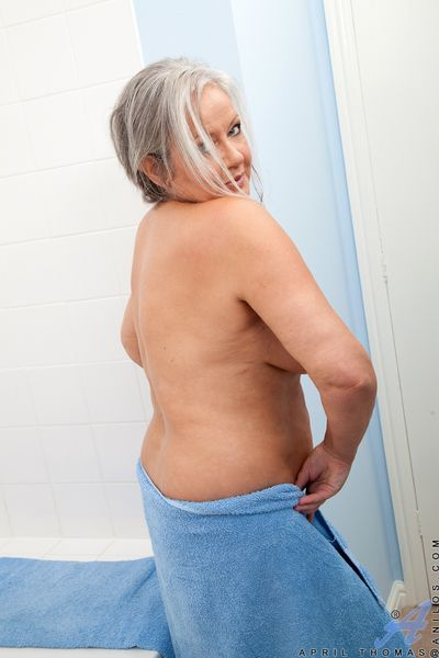 Chubby granny exposing large tits before spreading hairy pussy