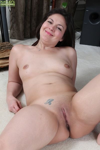 Mature lady Penny Prite revealing small tits before spreading smooth vagina