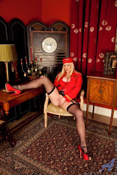Filthy bosomy milf with blonde hair Michelle Barrett in uniform performs the upskirt masturbation
