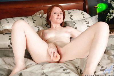Older lady with red hair Ariana jamming dildo up trimmed pink vagina
