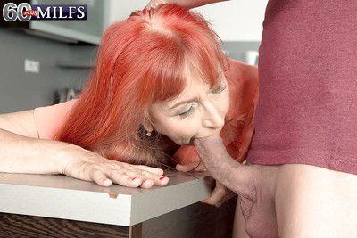 Over 60 granny Charlotta taking hardcore anal sex in kitchen