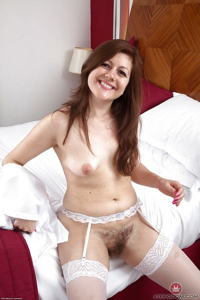 Mature model Lacey slipping off see thru underwear to flaunt hairy snatch