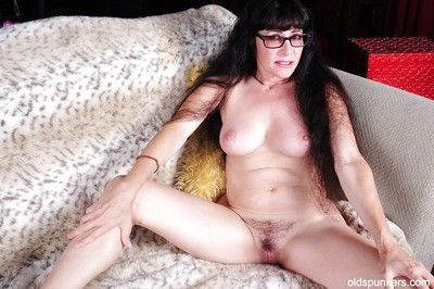 Close up posing features a big tits brunette granny Tammy in glasses