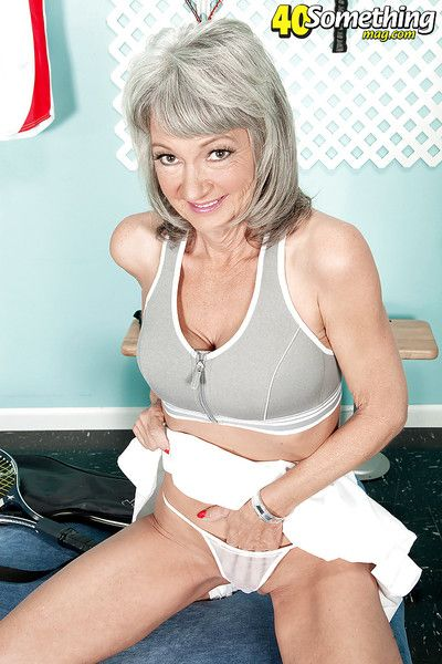 Horny granny Cheyanne doffing tennis clothes before spreading cunt wide open