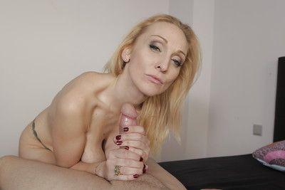 Mature blonde woman Daniela Evans sucking ball sac while jerking off cock