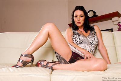 The seducing milf Rayveness shows panty up dress and slides the hand inside