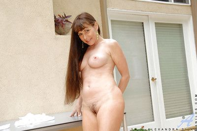 Mature woman Alexandra Silk flashing upskirt panties and big tits outdoors