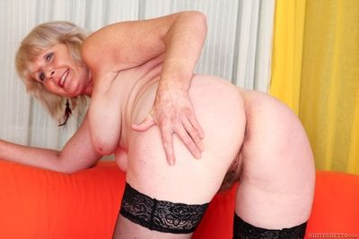 Stocking clad granny Evelin A spreading hairy cunt for hardcore fucking