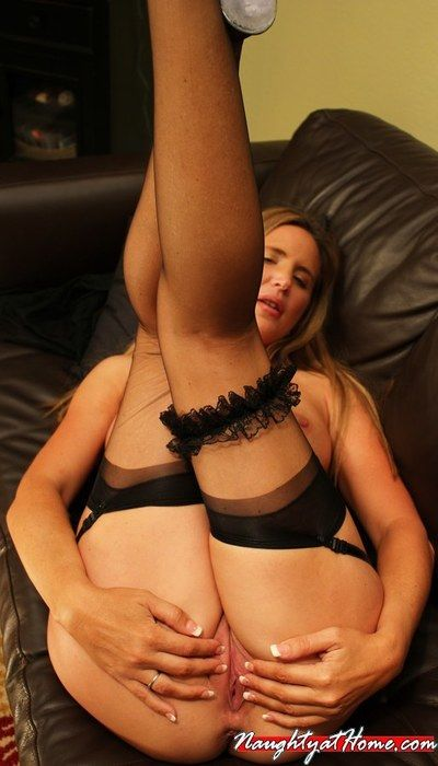 Blonde milf Desirae Spencer in black corset and stockings displays her mature pussy