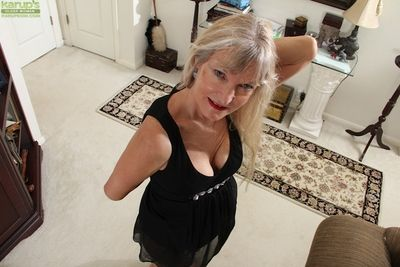 Blonde granny Lisa Cognee demonstrates her shaved pussy in close up