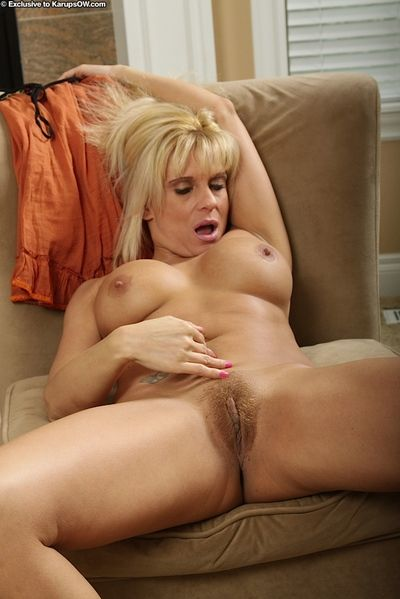 Older blonde woman Jess Jameson exposing large tits and erect nipples