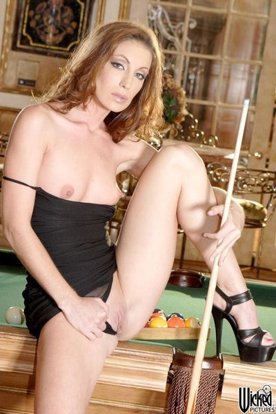 The salacious brunette milf Brandi Lyons is playing billiard and slowly stripping
