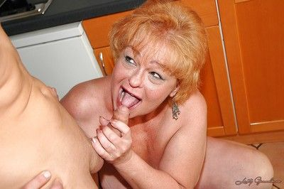 Redhead fatty granny gets her twat fingered and fucked by a younger guy