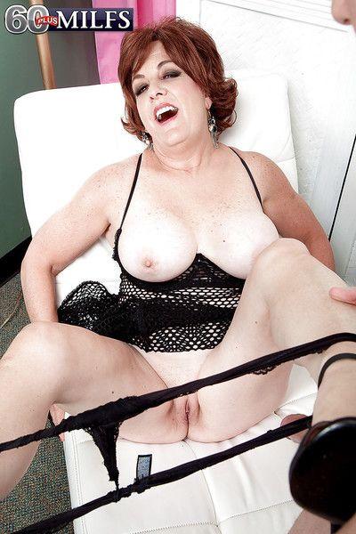 Busty redhead granny Gabriella LaMay taking cumshot after hardcore fucking