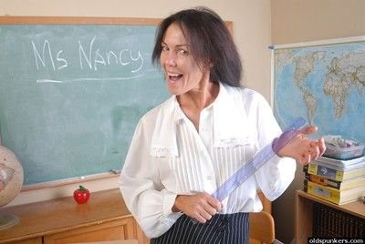 Naughty granny Nancy gets completely naked in the school room