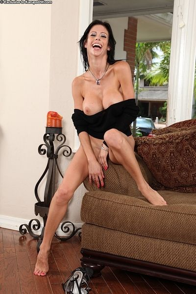 Aged brunette model Alexis Fawx revealing big fake tits before masturbating