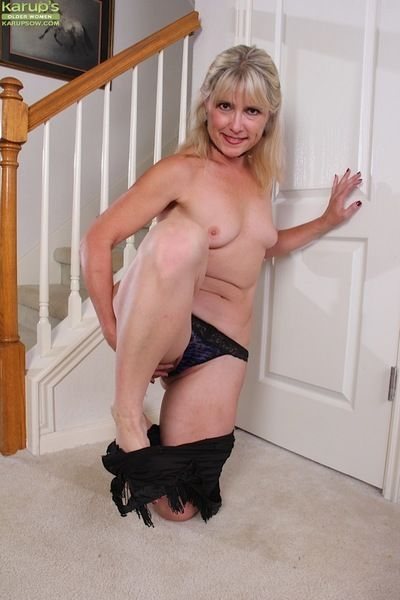 Mature lady Rebecca Hill reveals bare ass and shaved cunt after stripping