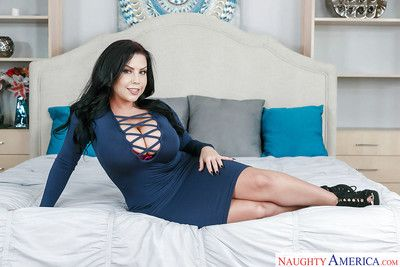 Brunette mom Sheridan Love revealing huge all natural tits and tattoos on bed