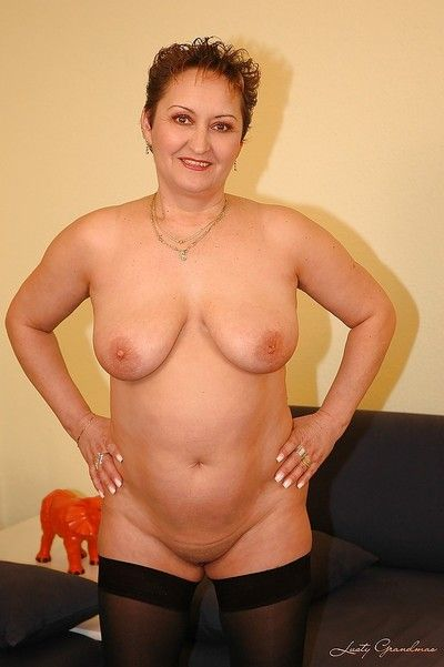 Fatty granny with big tits spreads her wet cunt horny for sex