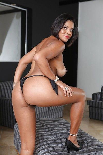 Mature Latina brunette Ana Luz demonstrates her big tits and ass