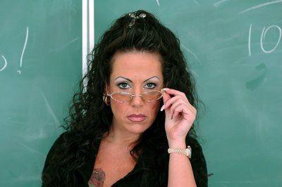 Mature teacher in glasses Anjelica Lauren strips to black stockings