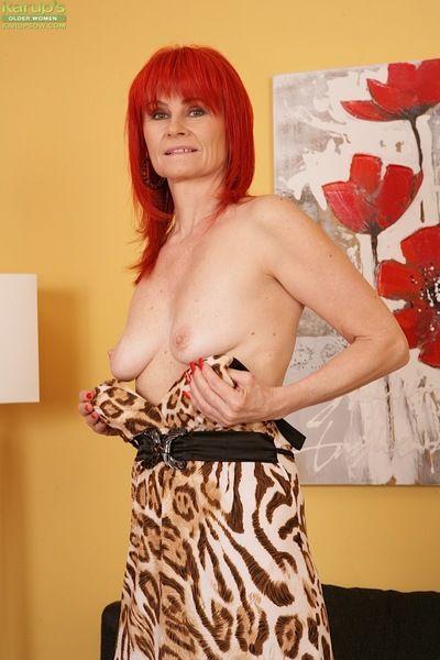 Busty aged redhead Amanda Rose masturbating hairy snatch in high heels