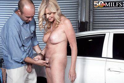Older blonde lady Lauren Taylor receiving sperm on face after fucking mechanic
