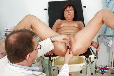 Fatty granny in glasses gets her tits and twat examed by gyno