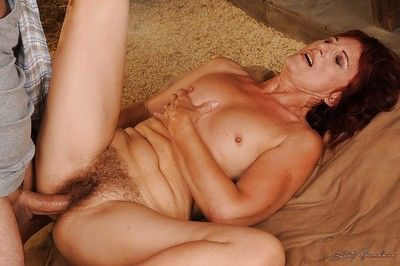 Redhead granny gets her shaggy pussy licked and slammed in the barn