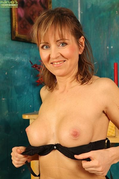 Mature woman with big boobs spreading hairy pussy in high heels