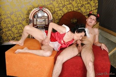 Granny in a sexy uniform teases her pussy and gets banged hard
