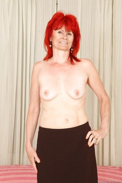 Redheaded granny Patricie spreading pussy and playing with tits