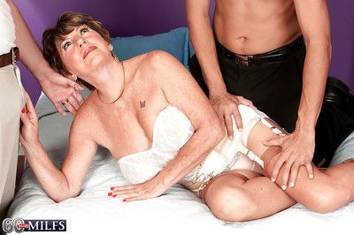 Hot granny in nylon stockings Bea Cummis penetrated by two dicks
