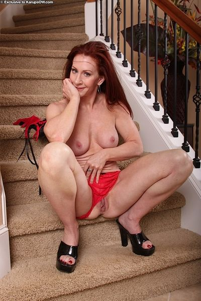 Mature redhead Catherine De Sade loosing shaved pussy from panties