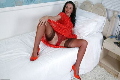 Clothed mature woman Marlyn brings the charm of sexy atmosphere