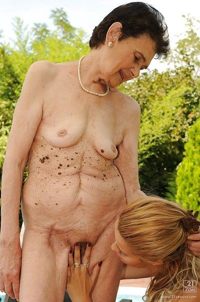 Young babe with a lesbian granny teasing pussies outdoor
