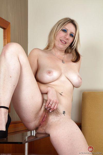 European mature Mel Harper takes off transparent panties revealing hairy twat
