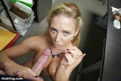 Older pornstar Cheri DeVille licking ball sac while jacking big dick