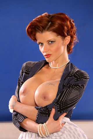 Clothed redhead Joslyn James in nylon stocking exposes her big tits and snatch