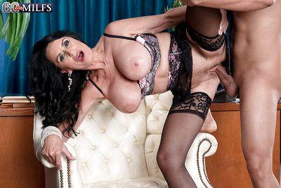 Brunette cougar Rita Daniels baring large granny tits before hardcore sex