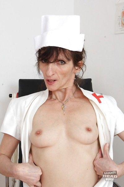 Naughty head nurse Andula flashing granny tits and pussy in hospital room