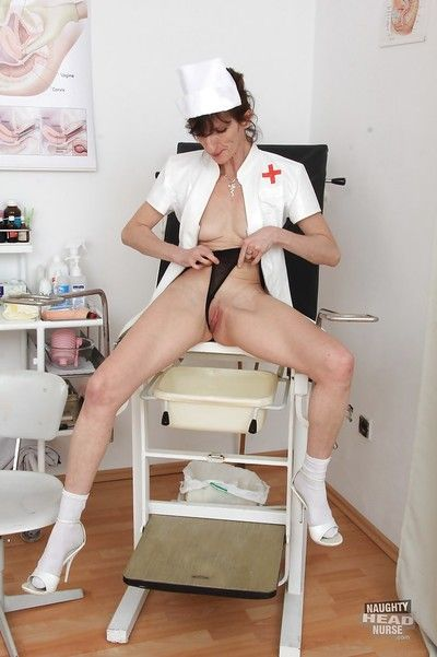 Naughty head nurse Andula flashing granny tits and pussy in hospital room