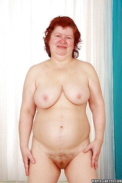 Fatty redhead granny with massive jugs stripping off her clothes