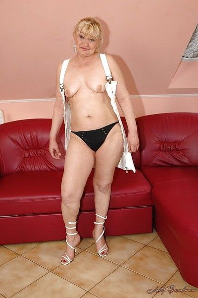Chubby granny on high heels taking off her dress and panties