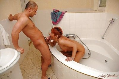 Short haired granny gives a blowjob and gets pounded in the bath