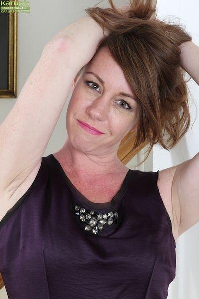 Jiggy mature slut with tiny tits Joanie Bishop makes close-ups of cunt