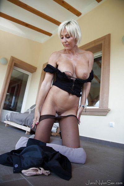 Older blonde UK model Jan Burton strutting outdoors in pantyhose