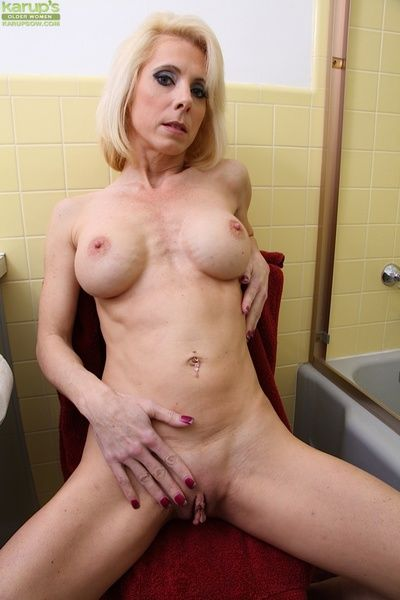 Slutty mature Jodie Stacks taking a shower and playing with tits