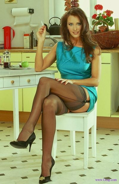 Sexy legged milf Angie George in black stockings and heels shows off her big jugs and snatch